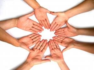 Image of a circle of hands faced palm-up